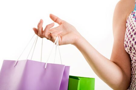 Close-up of human hand carrying shopping bags over white background Stock Photo - 4258047