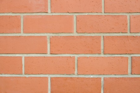 embed: Close-up of reddish brickwall of new urban construction