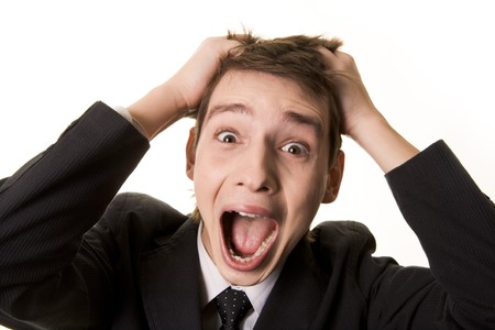 Portrait of frustrated businessman screaming while keeping his hands on head Stock Photo - 4322391