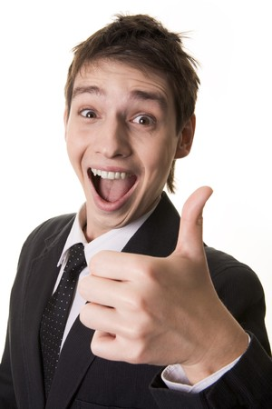 Portrait of amazed businessman with open mouth keeping his thumb up Stock Photo - 4321304