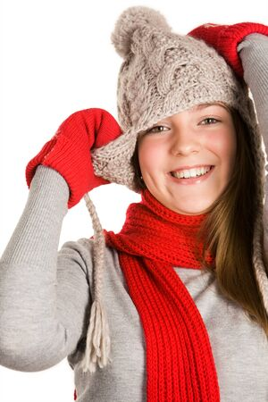Portrait of beautiful young girl wearing grey knitted cap and sweater photo