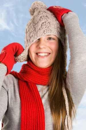 Portrait of cheerful teenage girl wearing warm knitted clothes photo