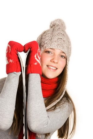 Image of lovely skier in warm clothes over white background photo
