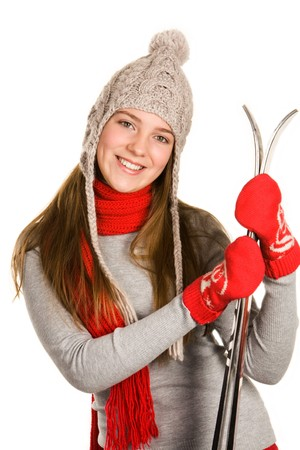Portrait of positive sporty woman with skis looking at camera and smiling photo