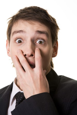 Image of shocked businessman hiding his mouth under hand and looking at camera with widened eyes Stock Photo - 4321308