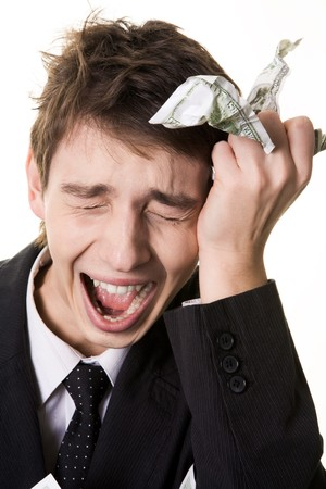 Image of crying businessman touching his head and holding crumpled dollar note in hand Stock Photo - 4321393