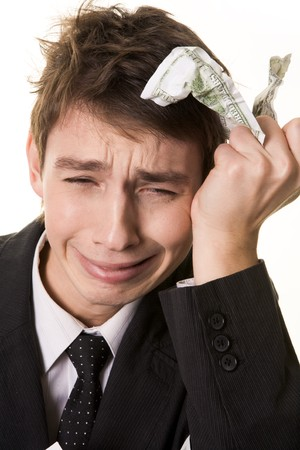 Photo of grieving businessman with crumpled banknote in his hand Stock Photo - 4321395