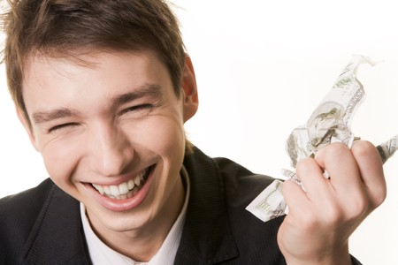 Photo of laughing male with crumpled dollar banknote in hand over white background photo