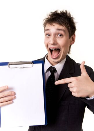 Photo of surprised businessman pointing at blank paper in his hand photo