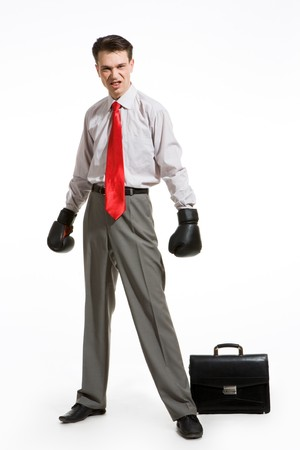 Portrait of aggressive businessman wearing boxing gloves over white background photo