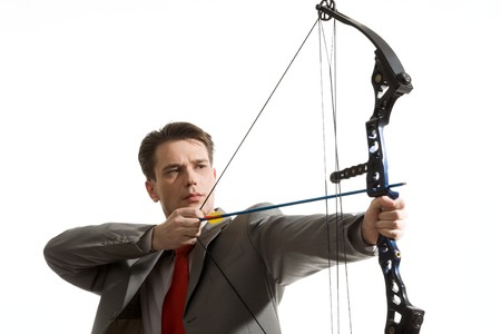 Portrait of concentrated male with crossbow in hands over white background photo