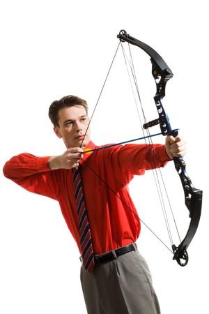 Conceptual image of serious man taking aim at something photo