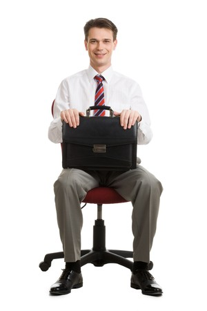 Portrait of cheerful boss sitting in armchair with case in hands Stock Photo - 4321260