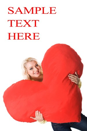 Image of joyful lady holding big red heart and smiling at camera photo