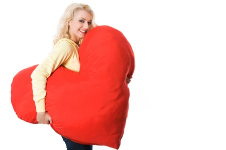 Portrait of pretty young woman with large toy heart giving you fantastic smile photo
