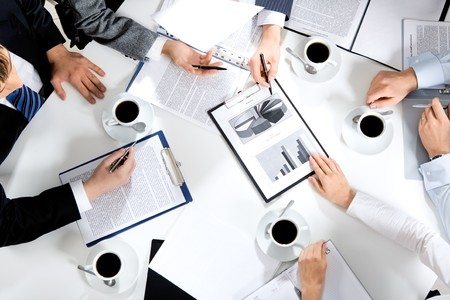 Close-up of business team sitting at the table and discussing a new project  Stock Photo - 4261140