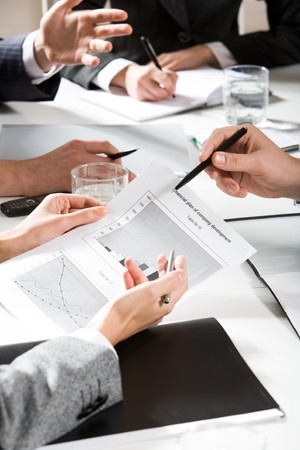 Vertical image of human hands during business discussion Stock Photo