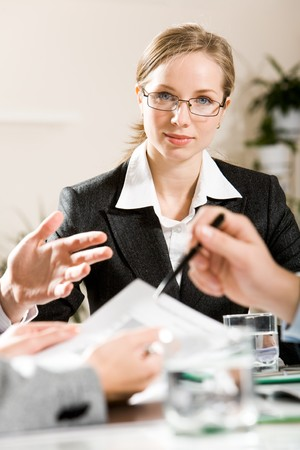 Photo of seus businesswoman at background with people�s hands in front of her Stock Photo - 4321323