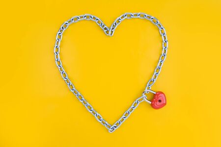 Chain forming heart shape being joined by a lock photo