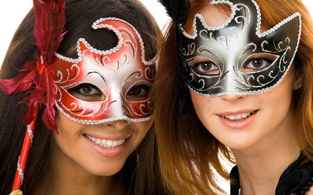 Portrait of two smart ladies in masks at masquerade photo