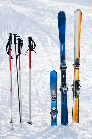 Image of skis and sticks in snowdrift on winter resort photo