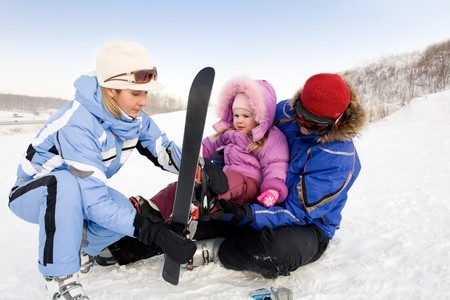Image of sporty family spending time on winter resort during vacations photo