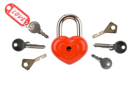 Image of red heart-shaped lock with several keys around on white background photo