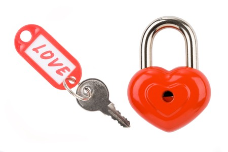 Photo of padlock and key with love label on a white background  photo