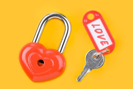Image of red lock and key with love label  photo