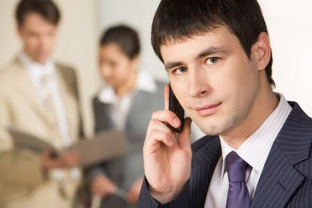 Portrait of successful businessman calling on mobile phone  photo