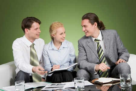 people communicating: Photo of confident business people communicating at meeting Stock Photo