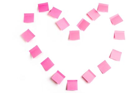 Abstract shape of heart made up of sticky paper pieces on white background Stock Photo - 4336451