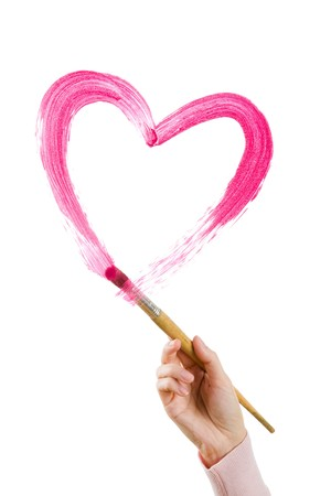 corazones: Photo of human hand holding brush and painting shape of heart on white backdrop Stock Photo