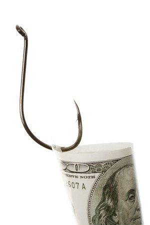 Sharp fishing hook with hundred dollar banknote on it