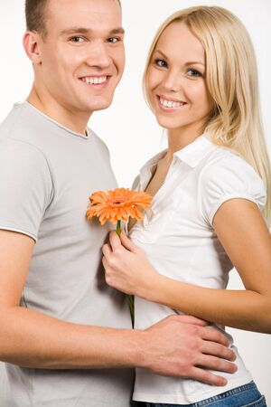 Portrait of happy couple looking at camera with smiles photo