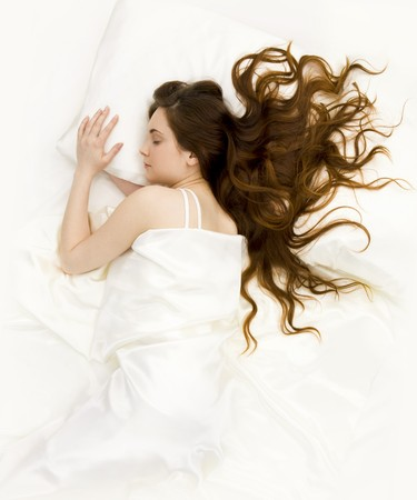 quiet adult: View of pretty young female lying in bed and having rest Stock Photo