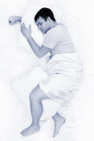 Black-and-white image of tired male having sweet dream at night photo