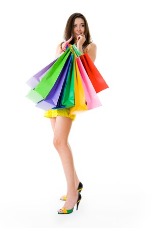 Photo of glamorous shopper with lots of bags isolated on white background photo