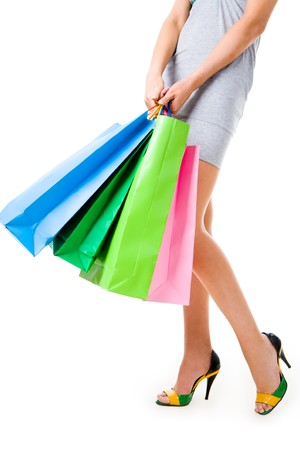 Image of slim female legs in fashionable shoes and paperbags in hands on white background Stock Photo - 4467443