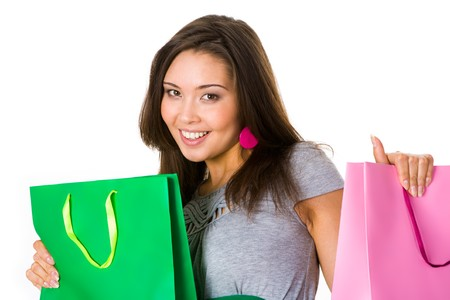 Portrait of positive shopper holding bags in hands and smiling at camera photo