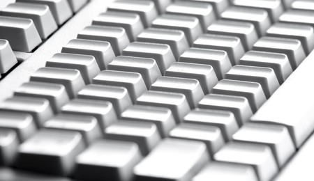 Close-up of four rows of buttons of computer keypad photo