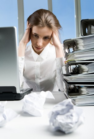 Image of tired businesswoman sitting at her workplace after hard working day photo