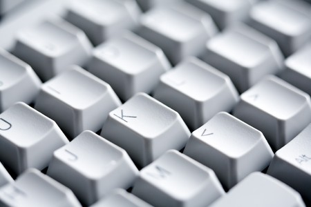 Macro image of white buttons of computer keypad with letters and symbols on them photo