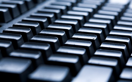Shot of laptop buttons with focus on central keys photo