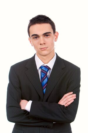 Portrait of young handsome businessman with crossed arms looking at camera Stock Photo - 4544868