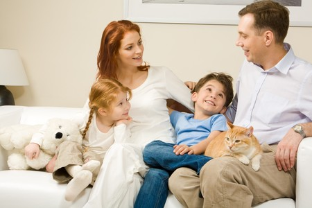 Curious children and woman listening attentively to man telling an interesting story Stock Photo - 4549527