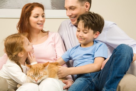 Portrait of affectionate parents and their children enjoying weekend day at home Stock Photo - 4549336