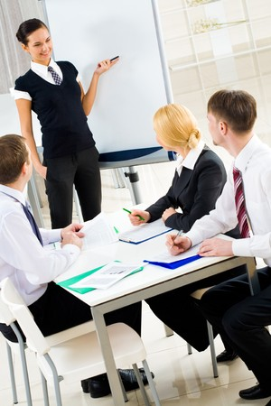 Photo of happy businesswoman sharing her ideas by whiteboard with partners Stock Photo - 4544940