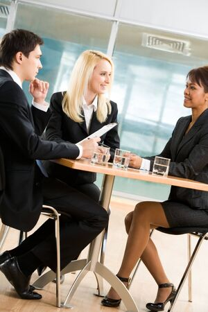 Image of contemporary associates discussing new project at briefing Stock Photo - 4549506