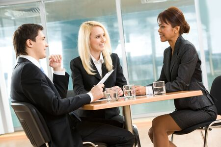 Photo of successful employees gathered around table explaining their ideas in office Stock Photo - 4549481